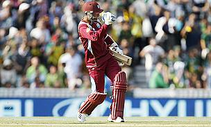 Ramdin clenches his first