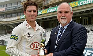 Gatting presents Burns with award