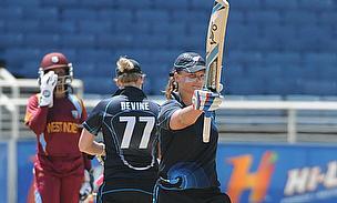 Suzie Bates raises her bat