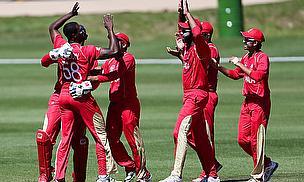 Canada celebrate a wicket