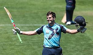 Calum MacLeod raises his bat