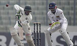 Mominul Haque plays a shot