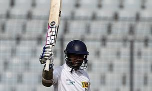Kumar Sangakkara raises his bat