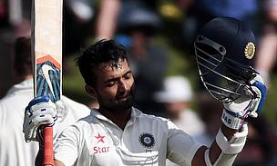Ajinjya Rahane raises his bat and helmet