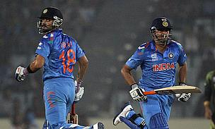 Virat Kohil and Suresh Raina take a run