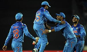 Indian fielders celebrate a wicket