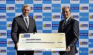 ICC Chief Executive David Richardson presents the cheque to CSA Chief Executive Haroon Lorgat