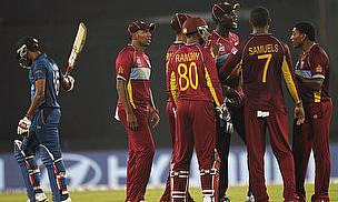West Indies players celebrate a wicket