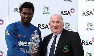 Angelo Mathews is handed the RSA Insurance Trophy by Cricket Ireland President Joe Doherty