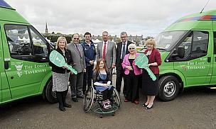 Staff of Anna Ritchie and St Andrews School take delivery of their Lord's Taverners minibuses