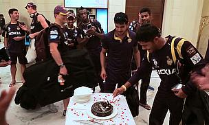 The Kolkata Knight Riders get stuck in to their cake following a win over the Sunrisers Hyderabad
