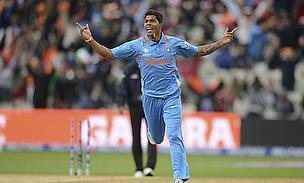 Umesh Yadav celebrates a wicket