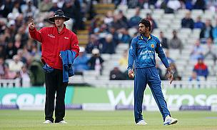 Sachithra Senanayake (right) looks on as Jos Buttler (not in picture) is given out after he Mankaded him