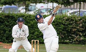Neil Godwin hits out for the first XI during their 68-run victory