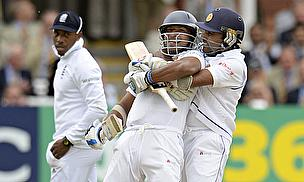 Mahela Jayawardene (right) joins in the celebrations