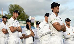 England players look on