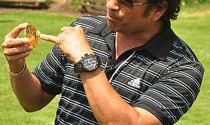 Sachin Tendulkar poses with his newly-minted coin