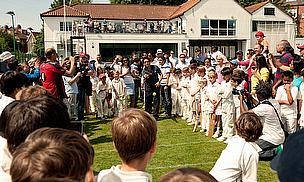 Tendulkar bowls to one of the junior cricketers