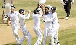 England celebrate the wicket of Bhuvneshwar Kumar