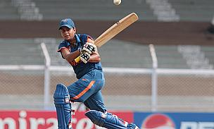 Karuna Jain plays a shot during the 2013 Women's World Cup