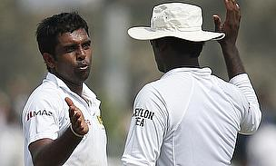 Dilruwan Perera celebrates with Angelo Mathews