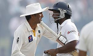 Kumar Sangakkara (right) is congratulated by Younus Khan after scoring his double-century