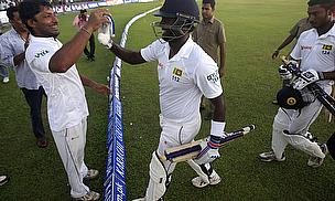 Sri Lanka celebrate after their fine win in Galle