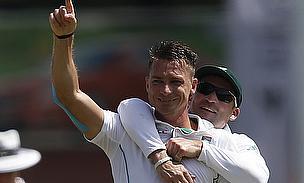 Dale Steyn celebrates a wicket with Dean Elgar