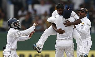 Sri Lanka celebrate after taking the wicket of Asad Shafiq late on day four