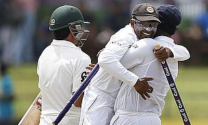 Mahela Jayawardene (centre) and Kumar Sangakkara (right) embrace after Sri Lanka wrapped up victory over Pakistan