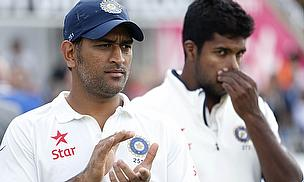 MS Dhoni (left) and his players have been fined heavily for bowling their overs slowly at The Kia Oval
