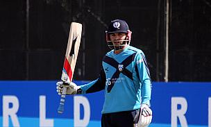 Preston Mommsen raises his bat