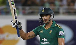 Faf du Plessis raises his bat in celebration
