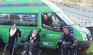 Chris Woakes and children from the Victoria Arts Specialist College showcase their new Lord's Taverners minibus