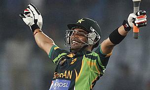 Umar Akmal celebrates