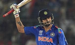 Virat Kohli raises his bat