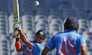 Suresh Raina hits out as Rohit Sharma looks on