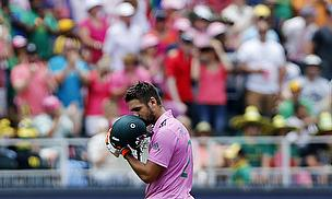 Rilee Rossouw kisses his helmet after reaching his maiden ODI century