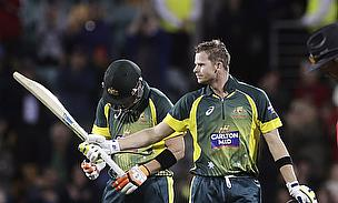 Steve Smith (right) celebrates his match-winning century in Hobart