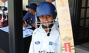 A youngster waits for his turn to bat during the Wicketz Festival