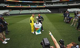 Michael Clarke and Brendon McCullum pose with the World Cup trophy
