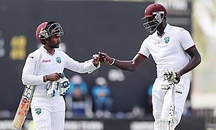 Denesh Ramdin (left) and Jason Holder (right) put on a 105-run stand as West Indies drew the first Test against England in Antigua.