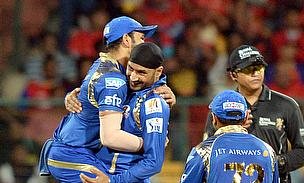 Harbhajan Singh celebrates the wicket of Chris Gayle as Mumbai Indians register their first win in this season of the IPL.