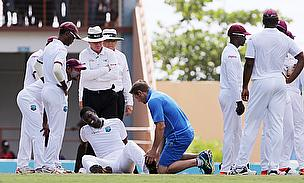 West Indies' Jason Holder receives treatment after sustaining an injury during day five of the Second Test in Grenada.