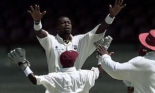 Curtly Ambrose celebrates a wicket