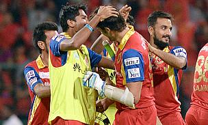 Royal Challengers Bangalore players celebrate the victory against Kolkata Knight Riders at Chinnaswamy stadium.