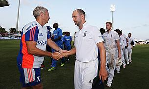 Peter Moores (left) shakes hands with Jonathan Trott (right) after England's defeat to West Indies in the Third Test in Barbados.