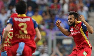 Harshal Patel (right) celebrating the wicket of Rohit Sharma during Royal Challengers Bangalore's clash with the Mumbai Indians on Sunday.