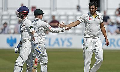 Mitchell Starc (right) celebrating the wicket of Jamie Foster (left) during the tour game against Essex.