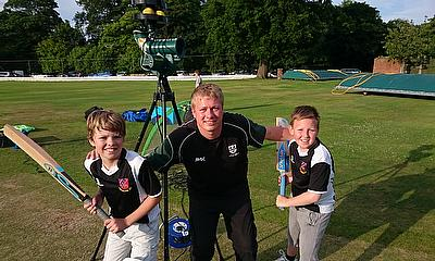Pedmore CC's Dan Such prepares to put the new Paceman bowling machine through its paces with members of the youth team